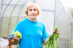 Portrait of mature woman in home garden Royalty Free Stock Image