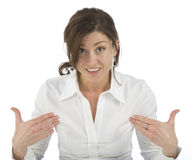 Portrait of mature woman indicating yourself. Portrait on white background of a forty years old woman in studio indicating yourself Stock Image