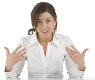 Portrait of mature woman indicating yourself. Portrait on white background of a forty years old woman in studio indicating yourself Royalty Free Stock Photos