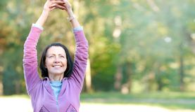 Portrait of mature woman before or after jog in the park Royalty Free Stock Image