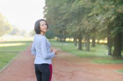 Portrait of mature woman before or after jog in the park royalty free stock photography