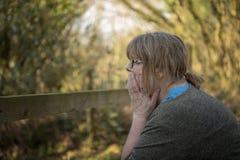 Portrait of mature woman outdoors. Portrait of mature woman thinking outdoors royalty free stock images