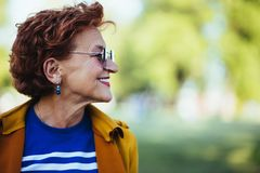 Portrait of a mature woman in the park. On a sunny day stock photos