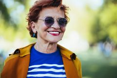 Portrait of a mature woman in the park. On a sunny day stock image