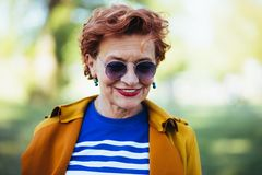 Portrait of a mature woman in the park. On a sunny day stock images
