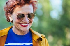 Portrait of a mature woman in the park. On a sunny day royalty free stock photo