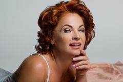 Portrait of a mature woman with red hair. royalty free stock photos