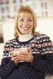 Portrait mature woman relaxing at home Stock Photos