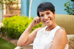 Portrait Of Mature Woman Relaxing Outdoors In Garden Royalty Free Stock Photography