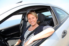 Portrait of mature woman sitting at driver's wheel Stock Photography