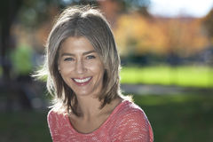 Portrait Of A Mature Woman Smiling At The Camera. Royalty Free Stock Image