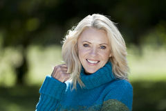 Portrait Of A Mature Woman Smiling At the Camera Royalty Free Stock Photo