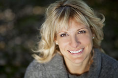Portrait Of A Mature Woman Smiling Stock Images