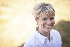 Portrait Of A Mature Woman Smiling Outside Royalty Free Stock Photos