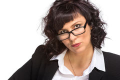 Portrait of mature woman smiling, wearing glasses, looking at ca Royalty Free Stock Image