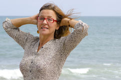 Portrait mature woman at stormy ocean weather Stock Photography