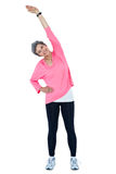 Portrait of mature woman stretching Stock Photography