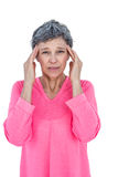 Portrait of mature woman suffering from headache Stock Images