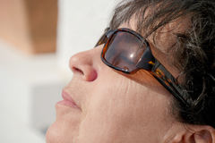 Portrait of mature woman with sunglasses Royalty Free Stock Photo