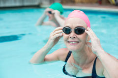 Portrait of mature woman swimming in pool. Close up portrait of mature woman swimming in pool Royalty Free Stock Images