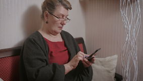Portrait of a mature woman talking on telephone stock video