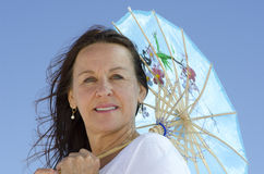 Portrait mature woman with umbrella Stock Photography
