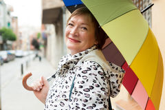 Portrait of mature woman with umbrella Royalty Free Stock Photo