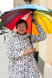 Portrait of mature woman with umbrella Royalty Free Stock Photos