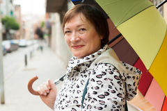 Portrait of mature woman with umbrella Royalty Free Stock Photography