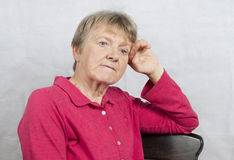 Portrait of a mature woman with a worried facial expression. Royalty Free Stock Image