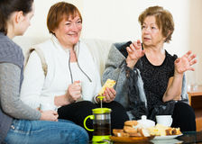 Portrait of mature and young women with tea Stock Photo