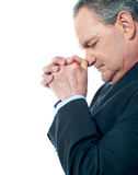 Portrait of matured businessman praying Stock Photography
