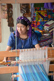 Portrait of a Mayan woman weaving a tissus Stock Photo
