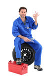 Portrait of a mechanic. Surrounded by equipmant stock photography