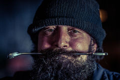 Portrait of mechanic with beard Stock Image