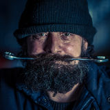 Portrait of mechanic with beard Royalty Free Stock Image