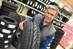 Portrait of mechanic in car shop Stock Images