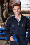Portrait Of Mechanic In Garage With Air Hammer stock photo