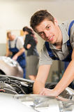 Portrait of mechanic repairing car Royalty Free Stock Photography