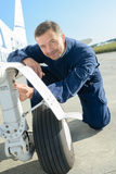 Portrait mechanic working on aircraft`s landing gear Royalty Free Stock Photography