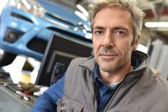 Portrait of mechanic working in repair workshop Stock Image