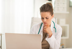 Portrait of medical doctor woman with laptop Royalty Free Stock Image