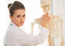 Portrait of medical doctor woman showing spine Royalty Free Stock Images