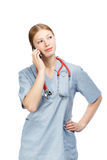 Portrait of medical doctor woman with stethoscope using phone Royalty Free Stock Photography