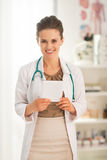 Portrait of medical doctor woman with tablet pc Stock Photos