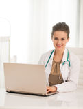 Portrait of medical doctor woman using laptop Royalty Free Stock Photography