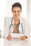 Portrait of medical doctor woman using tablet pc. Portrait of happy medical doctor woman using tablet pc Stock Photos