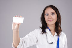 Portrait of Medical Female Doctor Presenting and Showing White C Stock Photography