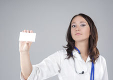 Portrait of Medical Female Doctor Presenting and Showing White Card Royalty Free Stock Photography