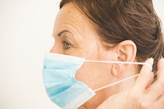 Portrait medical nurse with mask over face Royalty Free Stock Photography